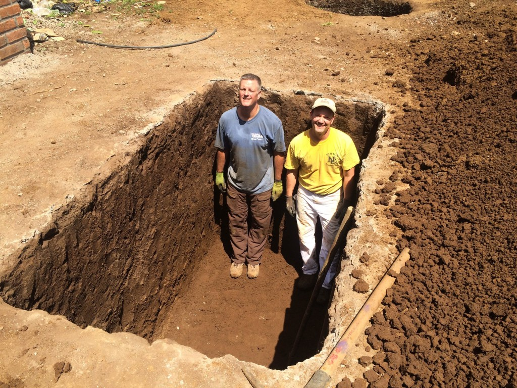 Greg and Jerry in the septic hole they dug in El Salvador