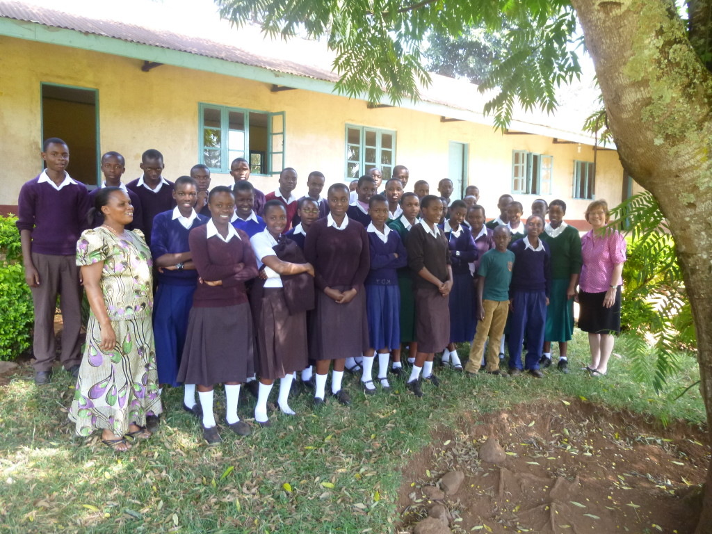 Headmistress Ester Nkya and the 40 orphans receiving scholarships at Nronga Secondary School.