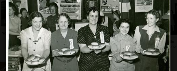 old black and white picture of women holding up homemade baked goods