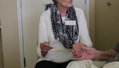 hospital visitation volunteer holding hands with patient