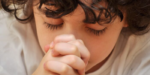 young child with praying hands